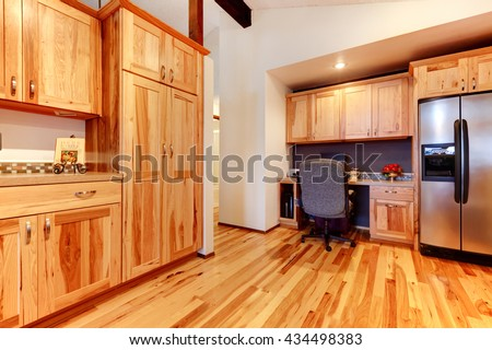 New Solid wood acacia kitchen custom made cabinets with hardwood floor. Large open space with vaulted ceiling.