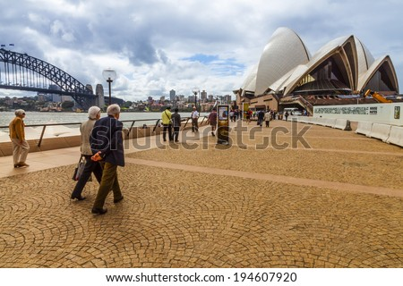 NEW SOUTH WALES, AUSTRALIA - APRIL 19 l : a couple of unidentified people and the others are walking to the Sydney Opera House in Bennelong Point,New South Wales,Australia on 19 April 2012 - stock photo