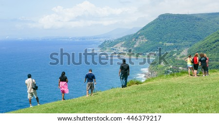 NEW SOUTH WALES, AUSTRALIA - JANUARY 21;Tourists stop to take in view of distant Sea Cliff Bridge a highlight along Grand Pacific Drive coastal route on January 21, 2011, New South Wales , Australia