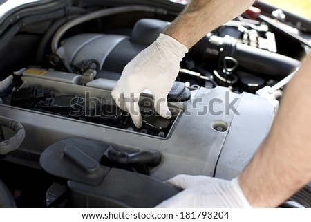 New spark plugs of a car being installed during a service - stock photo