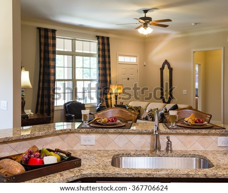 New stainless steel sink on a granite countertop - stock photo