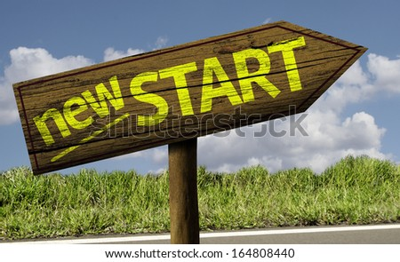 New Start wooden sign on the road - stock photo