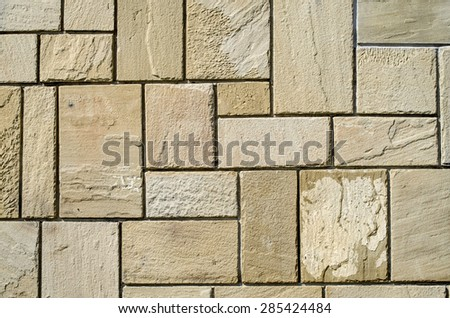 New stone cladding plates on the wall closeup