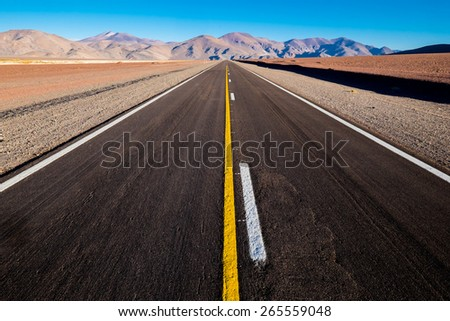 New straight road in the desert - stock photo