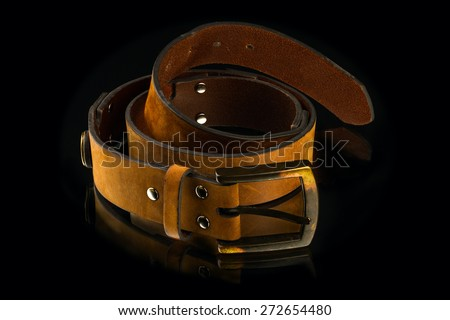 new stylish brown leather men's belt on mirror background