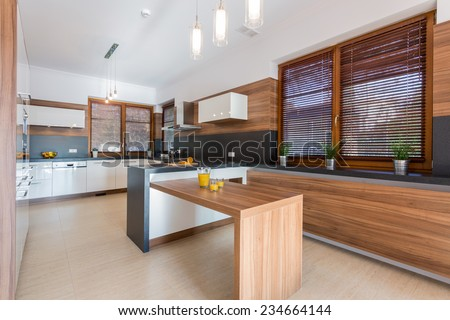 New stylish dining room in big residence - stock photo