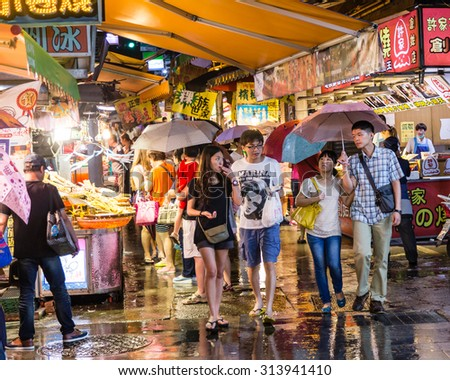 NEW TAIPEI CITY, TAIWAN - AUGUST 30, 2015: Shoppers walking around traditional market at Bali Left Bank Park. - stock photo