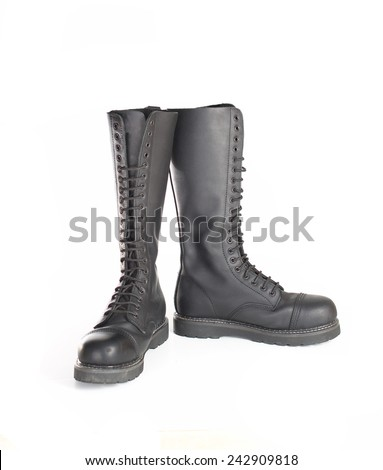 New tall lace-up knee-high black leather boots featuring 20 eyelets and steel-toes.  Fashion combat work boots worn by both men and women. - stock photo