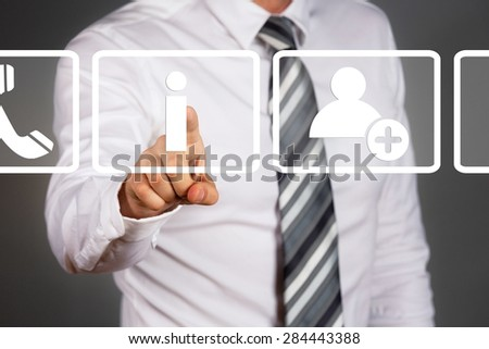New technology concept. Businessman touching display. White, simple info, contact, headphone icons.