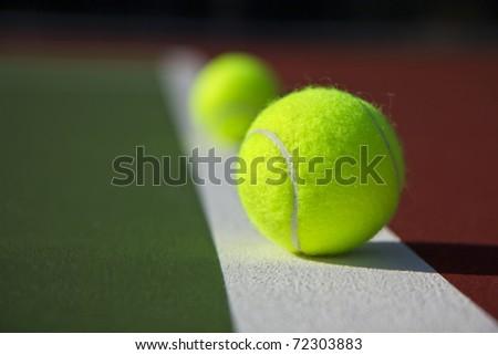 New Tennis Balls shot on  a outdoor tennis court - stock photo