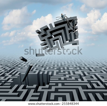 New thinking and empowerment concept as a businessman riding a chunk of a maze or labyrinth as a business or life success concept and solution symbol for finding the answer. - stock photo