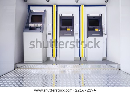 New three atm machines in public place - stock photo
