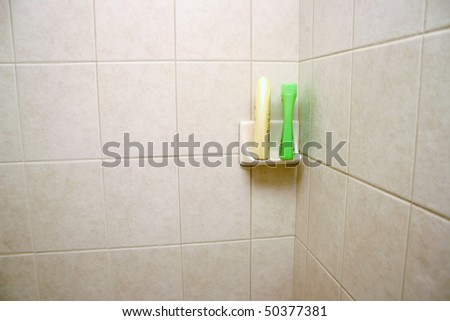 New tile shower space with shampoo shelf.