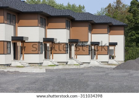 New townhouses nearing completion. - stock photo