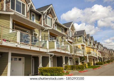 new townhouses or condominiums  - stock photo