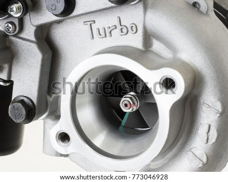 new turbocharged car engine Isolated on a light background