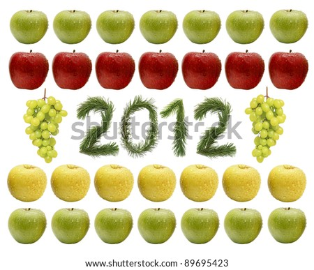 New two thousand twelfth. Numbers made of pine branches in an environment of multicolored fruit - apples and grapes