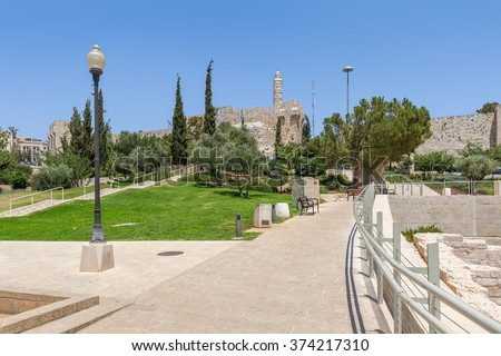New urban Teddy Park and Tower of David on background under blue sky in Jerusalem, Israel. - stock photo