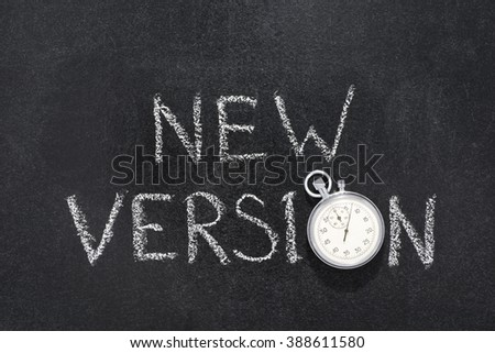 new version phrase handwritten on chalkboard with vintage precise stopwatch used instead of O