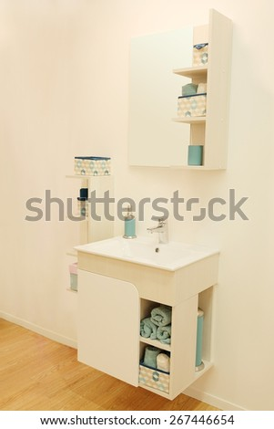 New washbowl with mirror in bathroom - stock photo