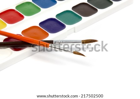 New watercolor box with two brushes isolated on white background