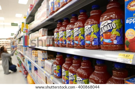 New Westminster, BC, Canada - April 03, 2016 : Beverages corridor in Walmart store inside Walmart store - stock photo