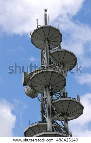 New Westminster, BC, Canada - August 22, 2016 : Close up Telus telecommunications tower equipment and repeater antenna dishes against blue sky