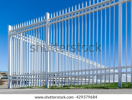 new white double fence made of metal - stock photo