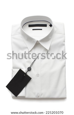 New white shirt folded against white background - stock photo