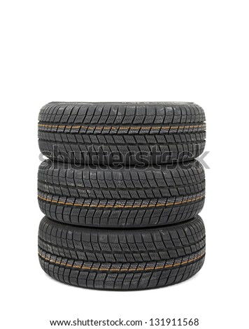 New winter tyres in a pile - stock photo