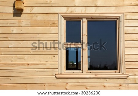 New wooden cottage window closeup - stock photo