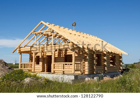 new wooden house built from logs - stock photo