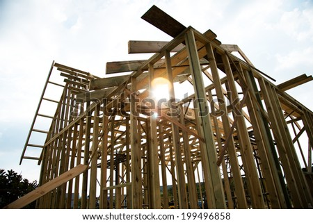 New wooden house under construction. - stock photo