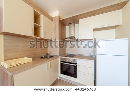 New wooden kitchen interior with appliances.