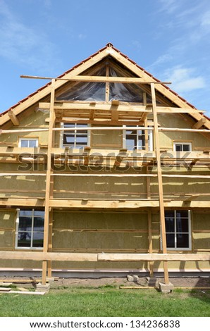 new wooden rural house thermal insulation with mineral rockwool - stock photo