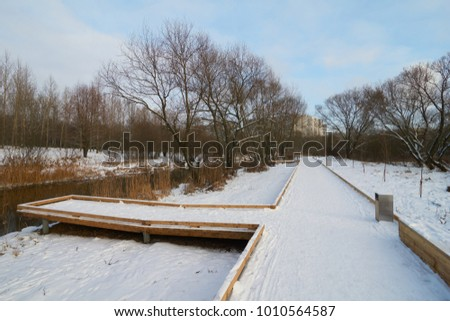 New wooden walkway near Yauza river in winter, Babushkinskiy district in Moscow