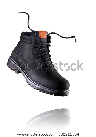 New working boots on white background