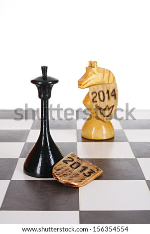 New year abstract chess game. 2013 year concedes rights to 2014 year - stock photo