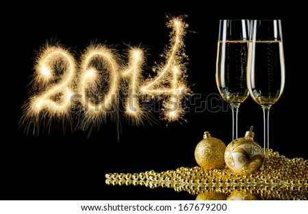 New Year - 2014 against the background of glasses of champagne and Christmas balls - stock photo