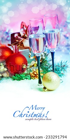 New Year and Christmas Celebration .Two Champagne Glasses in Holiday decoration.  - stock photo