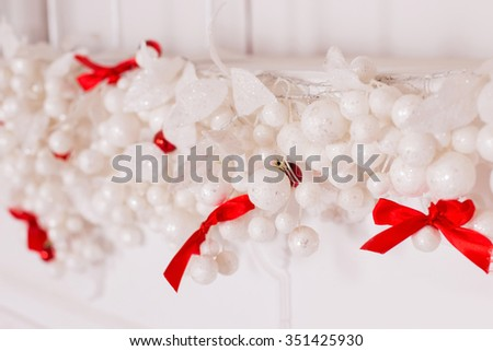 New Year and Christmas decoration. Red and white colors. Red ribbon and white balls. Selective focus