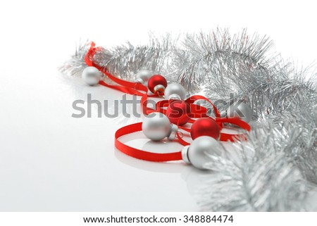 New year and Christmas greeting card template made of red ribbon, silver tinsel and balls with copy space, horizontal view, selective focus - stock photo