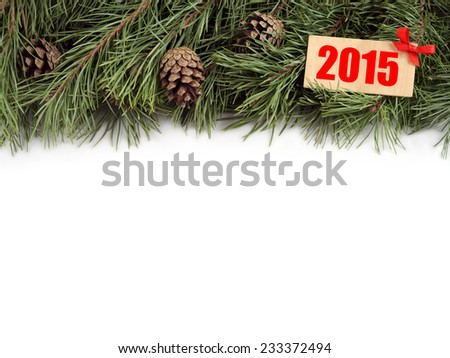 """New Year background. Christmas tree branch and bumps with wooden plate decorated with a bow with text """"2015"""" on a white background. - stock photo"""