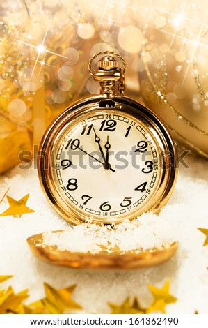 New Year background. pocket watch showing five minutes to midnight. - stock photo