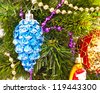 New year background with beautiful blue cone on furtree - stock photo