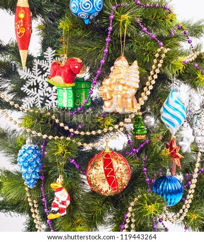 New year background with beautiful color decorations on fur-tree
