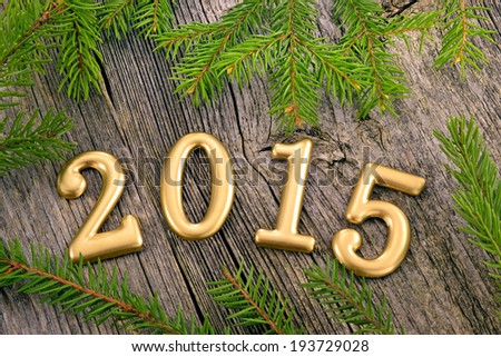 New Year background with decorations / Preview New Year background with decorations and fir twigs - stock photo