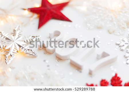 New Year 2017 background with stars confetti, red and silver snowflakes.