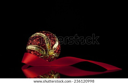 new-year ball for a decoration on a black background - stock photo
