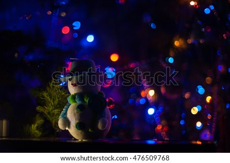 New year bokeh background with snowman